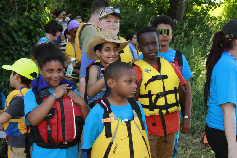 COURTESY: CONNIE GIBSON - Kids wait their turn to get on the water during the Columbia Slough Watershed Council's 'Explorando el Columbia Slough' program, designed to reach Spanish-speaking nature lovers.