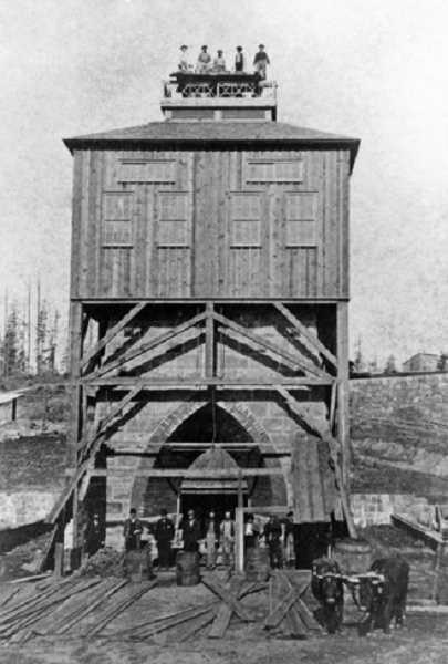 SUBMITTED PHOTO: LAKE OSWEGO PRESERVATION SOCIETY - The Oswego iron furnace under construction in 1866. George Wilbur, the furnace's principal architect, was only 20 years old at the time, yet he had already become widely known in New England as a master builder of iron furnaces.