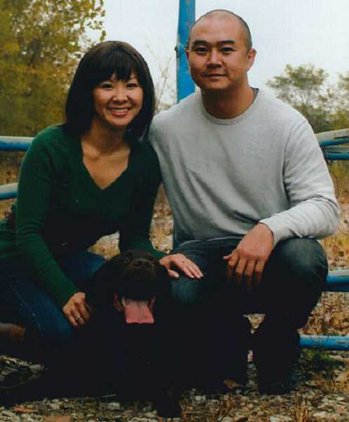 SUBMITTED PHOTO - Harris Tran has purchased Randol Family Dentistry. He is pictured here with Kylie Clark, his longtime girlfriend, and one of his dogs.