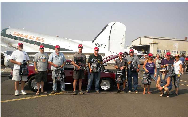 SUBMITTED PHOTO - The car show winners line up with their awards.