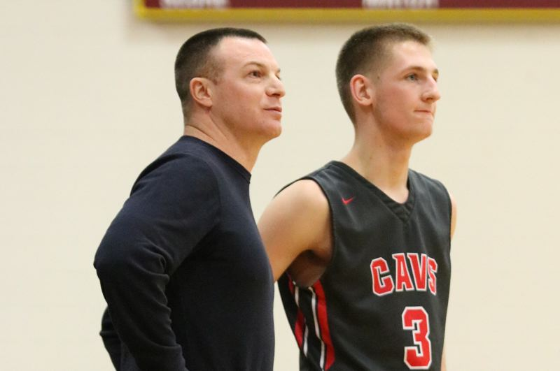 REVIEW/NEWS PHOTO: JIM BESEDA - Clackamas coach Ryan King (left) and senior Hunter Coyle check the clock during the Cavaliers' game at Central Catholic last season.