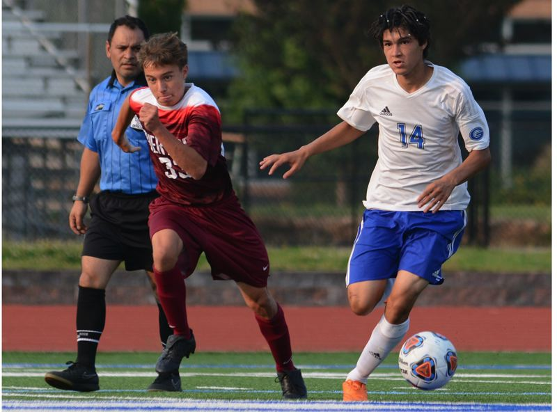 OUTLOOK PHOTO: DAVID BALL - Greshams Joel Gonzalez makes a move past a Sherwood player on a run through the midfield during Tuesdays 4-3 season-opening win.
