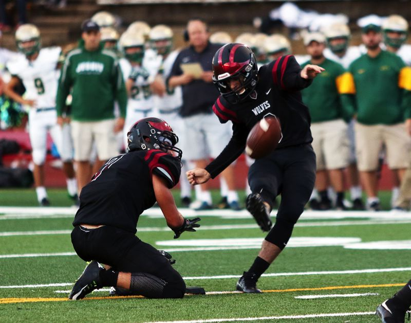 DAN BROOD - Junior Kyle Dernedde (right) will serve as quarterback, punter and place-kicker for the Tualatin High School football team this season.
