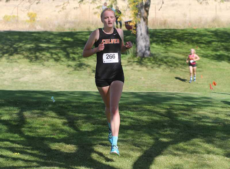 PIONEER FILE PHOTO - Culver senior Emma Knepp (front) placed seventh at last year's 3A/2A/1A Special District 5 Championships and recorded a personal best time. She, along with returning senior Hannah Orey, will be likely contenders at the district meet this year in Pendleton.