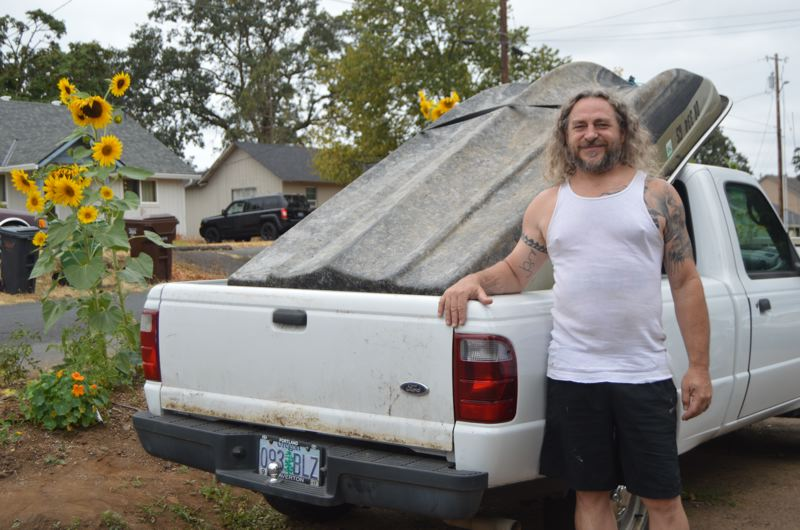 SPOTLIGHT PHOTO: NICOLE THILL - Eric Heassler stands in his front yard with a donated jon boat he plans to tow to Texas this week to help with disaster recovery after Hurricane Harvey hit the region. Heassler is planning to make the journey with at least one friend, and hopes others will join him along the way.