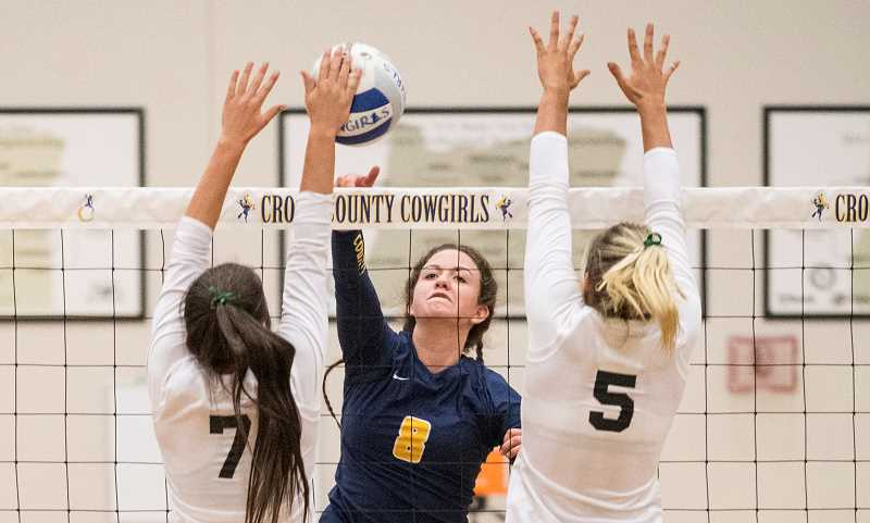 LON AUSTIN/CENTRAL OREGONIAN - Cassidy Dill goes up for one of her 13 kills during the Cowgirls' loss to Sisters on Tuesday. Dill, a senior team captain, was also a perfect 12-12 from the service line in the match.