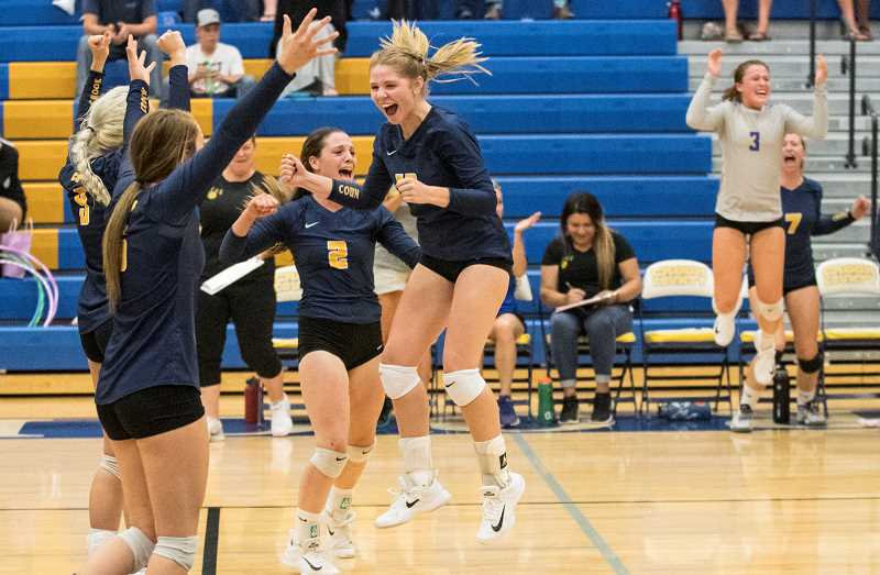 LON AUSTIN/CENTRAL OREGONIAN - The Crook County Cowgirls celebrate after winning the third set of their match with Sisters. Shown are Madison Kussman, Raegan Wilkins, Kennedy Buckner (2) and Anna Woodward (leaping). In the background are Kacie Stafford (3) and Lily Cooper (7).