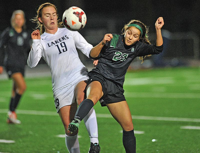 REVIEW FILE PHOTO - Lake Oswego's Emma DeVine (left) and the Lakers believe they'll be ready to challenge the Three Rivers League's best teams again in 2017.