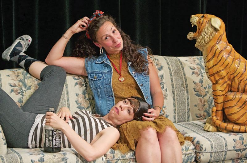 PHOTO BY CRAIG MITCHELLDYER - Annie Rimmer, left, as Grace, seeks comfort from her sister, Sherry, played by Heather Ovalle, in 'Tigers Be Still.' The play is Clackamas Repertory Theatres final offering of the season.
