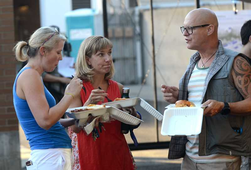 From left, Erin Patterson, Chelsea and Chris Mitchell enjoy the barbecue meal.