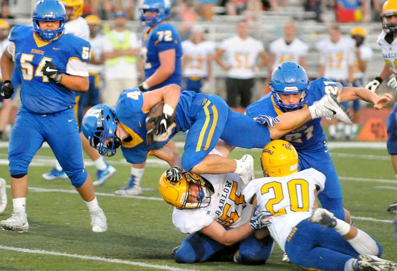 GARY ALLEN - Tiger Byron Morris scrambles for extra yards after contact with Bruin defenders during the Tigers opening season win over Barlow at Loran Douglas Field.