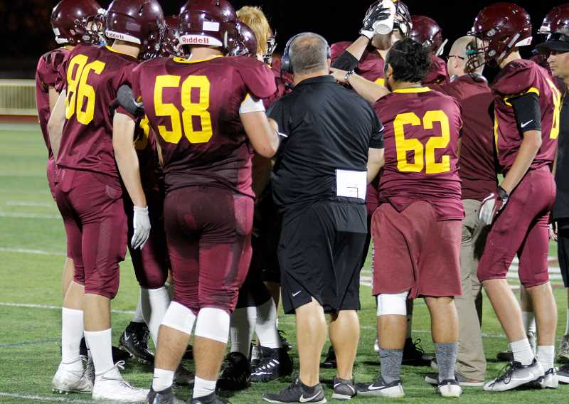 NEWS-TIMES PHOTO: WADE EVANSON - Forest Grove head coach Perry Herbst talks to his team during a timeout versus West Albany Friday, September 1.