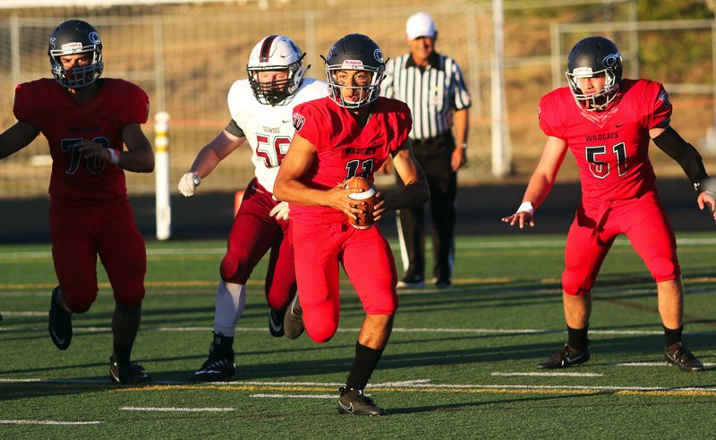 DAN BROOD - Westview junior quarterback Cielo Del Rosario looks for running room in Friday's game. Del Rosario had both a touchdown pass and a touchdown run against the Bowmen.