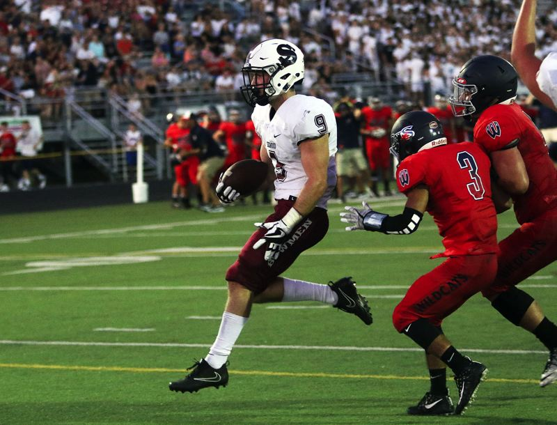 DAN BROOD - Sherwood senior Zach Jenkins scores on a 1-yard run late in the first half of Friday's game at Westview.