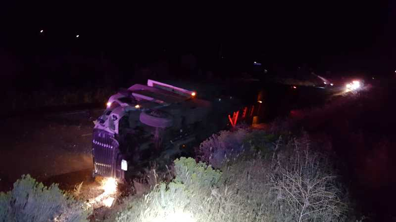 OREGON STATE POLICE - The semi-truck drove up the bank on the west side of the road and overturned, coming to rest on its side in the eastbound lane of Highway 26. The driver was injured.