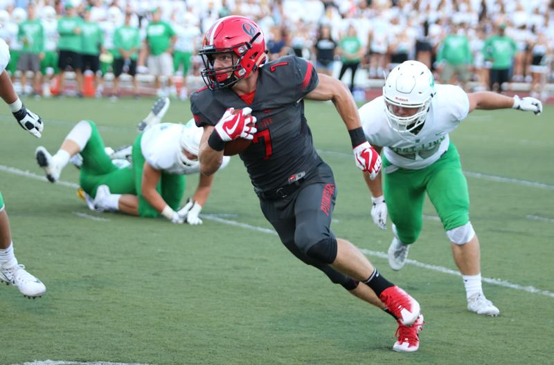 REVIEW/NEWS PHOTO: JIM BESEDA - Oregon City's Ethan Kassebaum finds running room in the first half of Friday's season opener agianst West Linn at Pioneer Memorial Stadium.