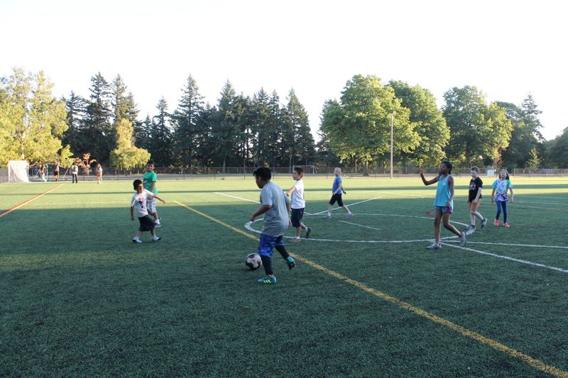 PORTLAND TRIBUNE: LYNDSEY HEWITT - The grass field at Lents park is a now an artificial-turf covered soccer field, part of nearly $41 million spent on parks projects in East Portland.