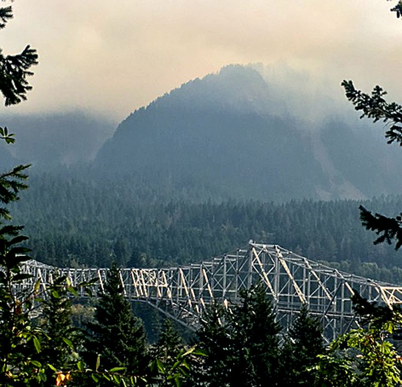 PAMPLIN MEDIA GROUP: JOHN SCHRAG - Smoke clung to the hills around the Bridge of the Gods near Cascade Locks during the weekend as the Eagle Creek Fire burned thousands of acres in the Columbia River Gorge. More smoke is expected in the Willamette Valley on Tuesday, Sept. 5, as the wind shifts from the east.
