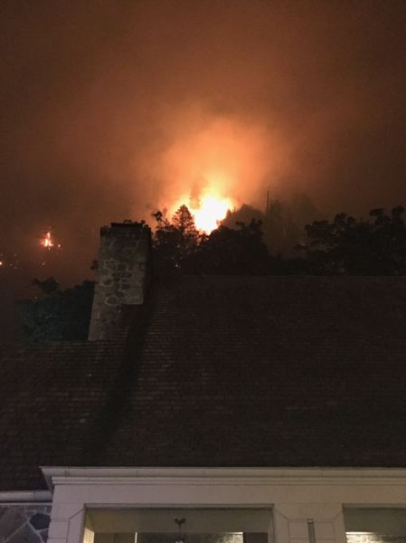 PHOTO COURTESY PORTLAND FIRE & RESCUE - Firefighters battle to save Multnomah Falls Lodge.