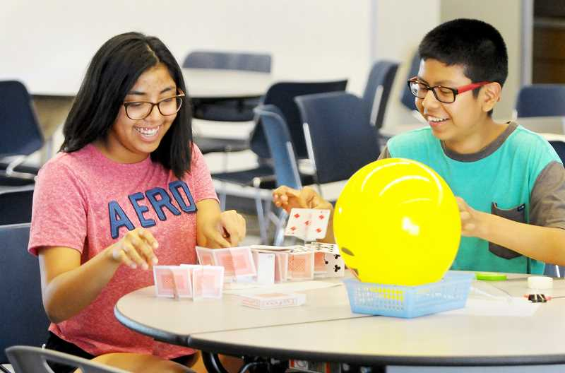 SETH GORDON - Incoming freshmen Isabella Campuzano and Ulysses Antonio work on a card-house challenge during the AVID program's first 'bootcamp' session of the year. Program leaders hope to offer at least one of the after-school social activities per month now that AVID is entering its third year at NHS.