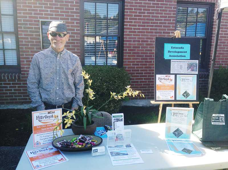 FILE PHOTO - During last years community trade fair, Phil Lingelbach provides information about Estacada Development Association activities.