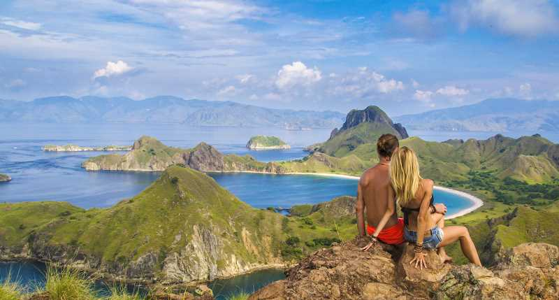 CONTRIBUTED PHOTO - Mark and Juliana Spicoluk of the YouTube channel Boho Beautiful admire the landscape in Komodo, Indonesia. As a part of their Positive Movement Tour across the U.S., the Spicoluks will hold a yoga class at Out to Pasture Animal Sanctuary near Estacada.
