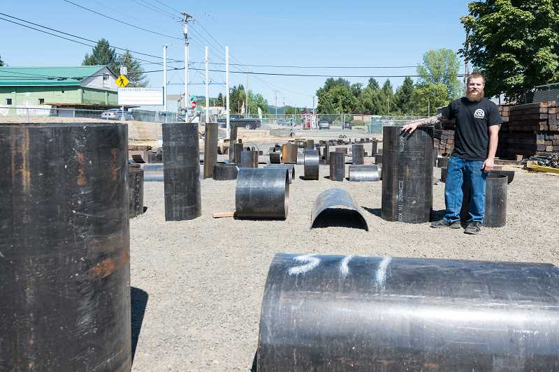 NEWS-TIMES PHOTO: CHRISTOPHER OERTELL - Brady Sheets will turn these large steel pipes into a pyramid-like art piece that will be installed in Tacoma.
