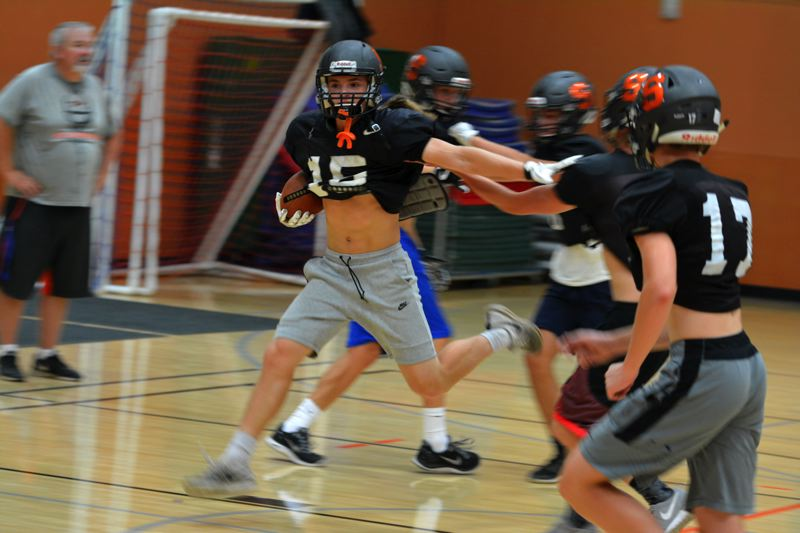 SPOTLIGHT PHOTO: JAKE MCNEAL - Indians sophomore running back Easton Decker lays a stiff-arm in practice.