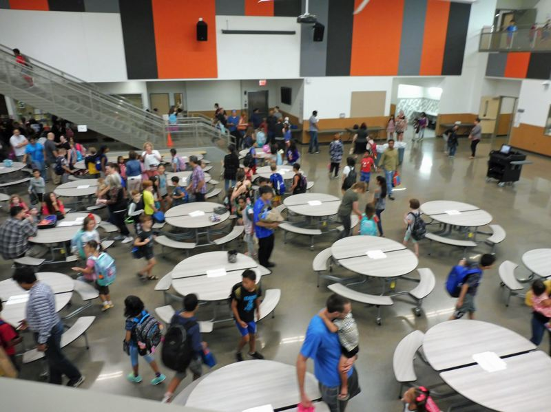 TIMES PHOTO: DANA HAYNES - Students and parents gather in the cafeteria for the first day of school at Beaverton's new Sato Elementary School.