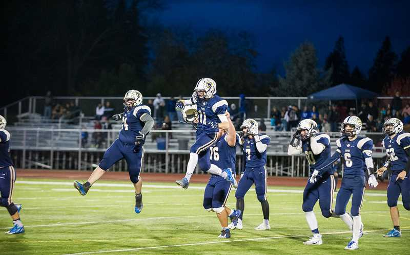 FOREST GROVE NEWS-TIMES FILE PHOTO - The Banks Braves football team celebrates following a postseason victory last season.