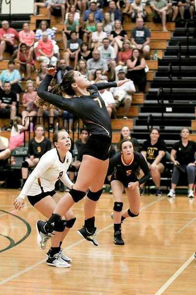 VICKI VANLOO PHOTOGRAPHY - Forest Grove's Kinsey Barnett goes up for a kill during a game last week. Barnett will be a key contributor for this year's Vikings.