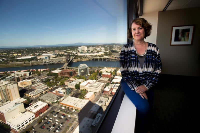 TIMES PHOTO: JAIME VALDEZ - Victoria Blachly, an attorney with Samuels Yoelin Kantor LLP, works on the 38th floor of the U.S. Bancorp Tower in Portland.