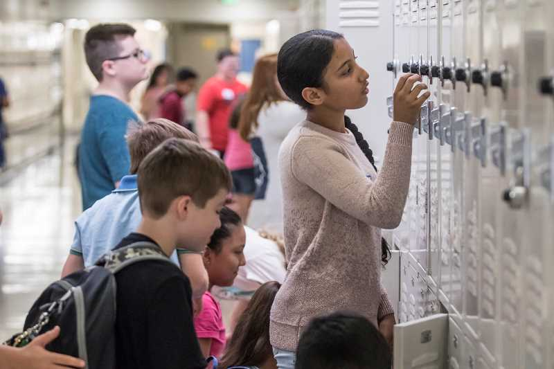 TIMES PHOTO: JONATHAN HOUSE - Fowler Middle Schooler Nabaa Al Rikabi figures out her new locker during orientation on the first day of school.