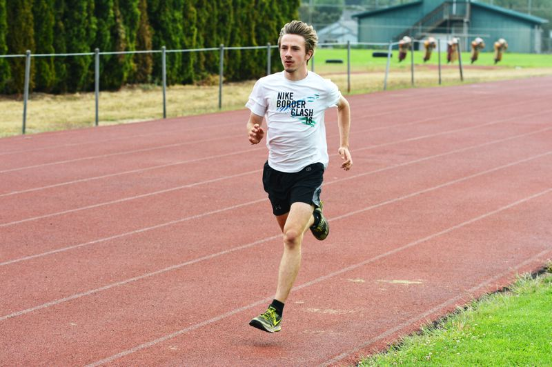 SPOTLIGHT PHOTO: JAKE MCNEAL - Indians senior John Kavulich ran to fourth in the Ultimook Race Nike Invitational Class 1A-4A in 17 minutes, 35.42 seconds on Saturday, Sept. 2, at Hydrangea Farms in Tillamook.