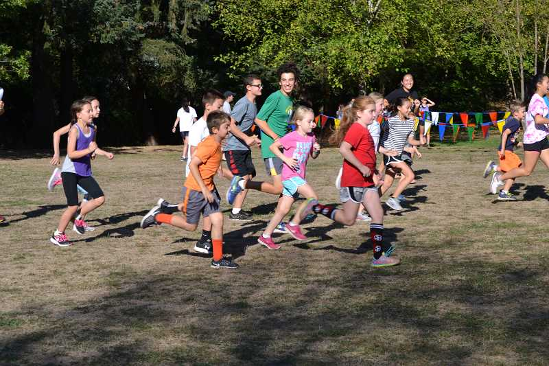 SUBMITTED PHOTO - The cross-country teams at Lakeridge and Lake Oswego high will lead youth in one-mile runs this fall. The events are free and open to those in grades 3-8.