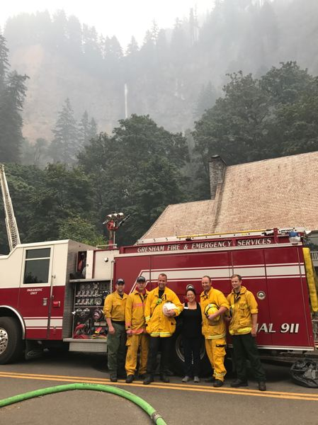 CONTRIBUTED PHOTO - Gresham Fire & Emergency Services firefighters pose with Multnomah County Commissioner Lori Stegmann on in front of  the fire-threatened Multnomah Falls Lodge on Wednesday, Sept. 6.