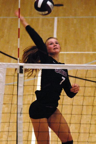 SANDY POST: MATT RAWLINGS - Olivia Caldwell goes up for the spike in Sandy's win over Milwaukie