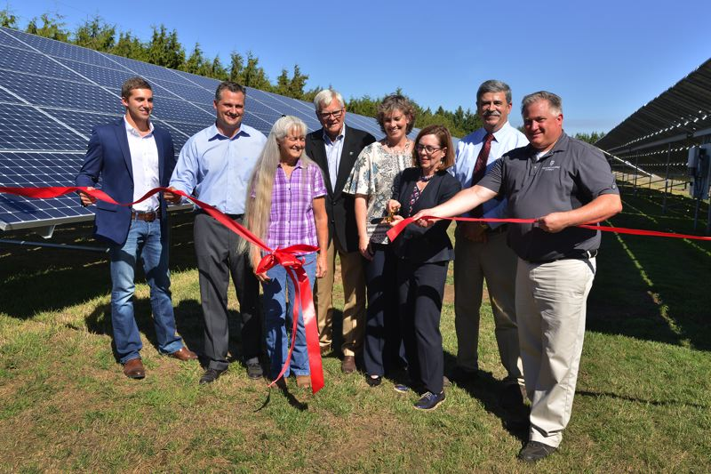 COURTESY NORTHWEST HAZELNUT COMPANY - Larry George, right, his brother and co-owner Shaun George, second from left, with other dignitaries at the ribbon-cutting of the solar array on Labor Day weekend.