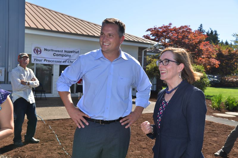 COURTESY NORTHWEST HAZELNUT COMPANY - Shaun George and Gov. Kate Brown talk during the celebration at Northwest Hazelnut Co.