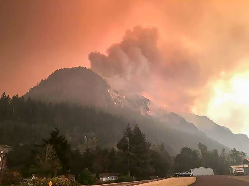 COURTESY PHOTO - Fire and smoke is visible in the Columbia River Gorge during the Eagle Creek wildfire.