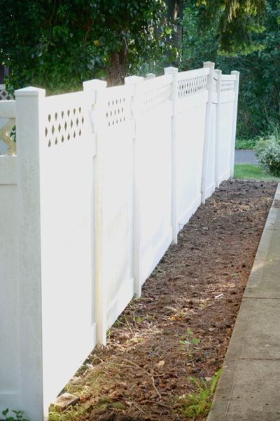 PAMPLIN MEDIA GROUP: JO OSTGARDEN - Vinyl fences don't look as earthy as wood fences, but they can provide a lower-maintenance alternative to wood fences.