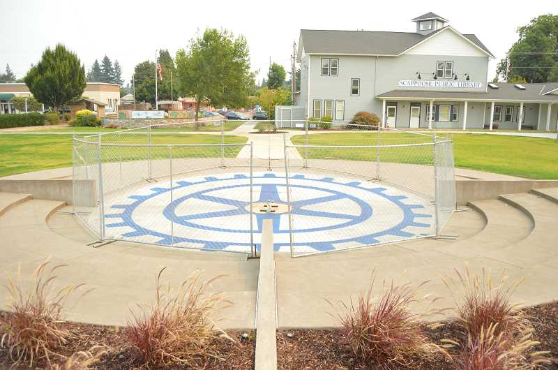 SPOTLIGHT PHOTO: DARRYL SWAN - Construction of the Scappoose Rotary Fountain is ongoing. Concrete staining planned this week was delayed due to ash fall from the Eagle Creek Fire. Organizers expect construction activity to pick up over the next few weeks, with completion in October.