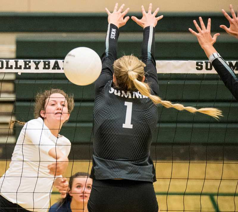 LON AUTIN/CENTRAL OREGONIAN - Cassidy Dill hits a spike past a double block from the Summit Storm. Dill finished with 10 kills to lead the Cowgirls, who lost to the Storm in straight sets.