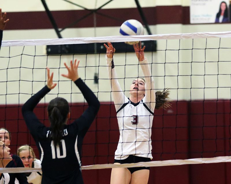 DAN BROOD - Sherwood senior Emily Bacewich (3) looks to put her shot over the net during the Lady Bowmen's match with Tigard.