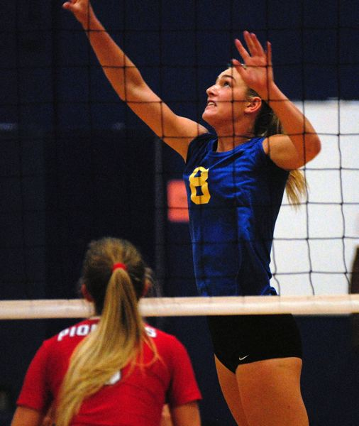 GRESHAM OUTLOOK: MATT RAWLINGS - Barlow's Megan Sester goes up for the kill.