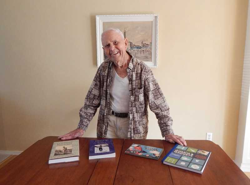 REGAL COURIER PHOTO: BARBARA SHERMAN - In his Summerfield home, Grant Valentine poses with his four published books on an expansion table that he built 76 years ago so he and his wife Frances could entertain guests in their small apartment.