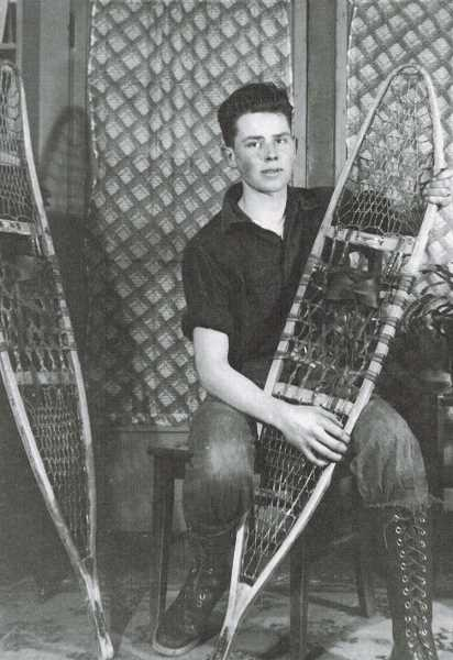 COURTESY OF GRANT VALENTINE - Grant Valentine holds snowshoes he used on trap lines in Scenic, Wash., when he was a junior at Skykomish High School in 1935.