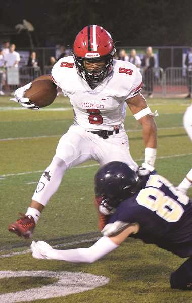 TANNER RUSS - Oregon City receiver Teron Bradford was a handful for the Canby defense Friday night.