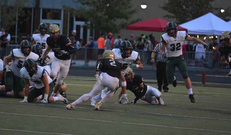TIMES PHOTO: MATT SINGLEDECKER - Tigard sophomore wide receiver Max Lenzy looks for open space against Southridge.