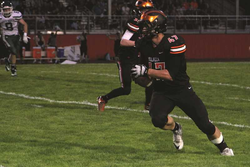 PHIL HAWKINS - Molalla junior Braden Hibbs put the Indians on the board first on Friday, taking a screen pass from Chase Jazdinski 19 yards for a touchdown midway through the second quarter.